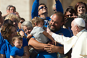 VATICAN CITY 04 OCTOBER 2017: A group from KOI Italia meets the Pope at the General Audience with Pope Francis on October 04, 2017 at Saint Peters Square in Vatican City, Rome, Italy.