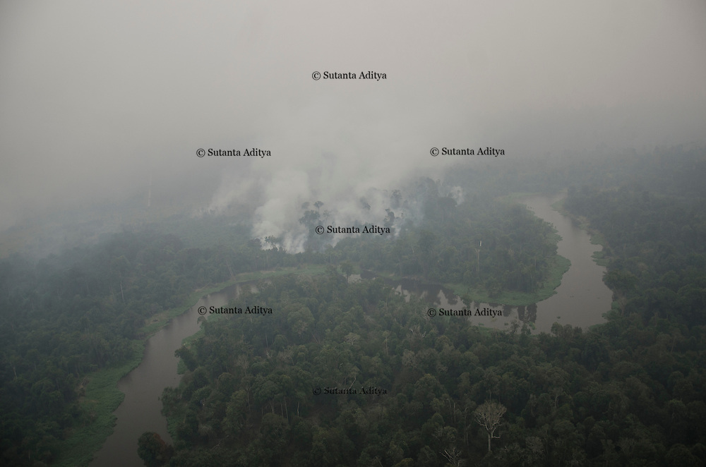 Pelalawan, Indonesia, September 13, 2015 : The spots of fire forest disaster seen from above by Indonesian Natural Disaster Management (BNPB) Kamov helicopter.