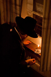 Pre-Pesach ritual called Chametz.  Performed prior to Passover.  Rabbi Asher Federman of the Chabad Lubavitch Jewish Center of the Virgin Islands and daughter Moussia and sons Mendel, Itche, and Levi