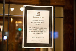 ©Licensed to London News Pictures 21/03/2020<br /> Chislehurst, UK. A notice on the door at the Queens Head pub in Chislehurst. The first night of pubs and restaurants closed in South East London due to the Coronavirus outbreak. Photo credit: Grant Falvey/LNP