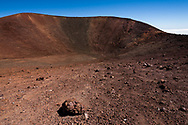 Inner  slope of a small volcanic crater at the summit of Mauna Kea. Summit is at the upper left.. Clear dry sky far above the cloud layer is evident. Big Island, Hawaii, © 2010 David A. Ponton