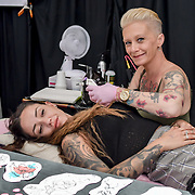 The Great British Tattoo Show getting bigger and better, hundreds of tattoo fans have tattoo done by tattoo artists and many live preformance and fashion show at Alexandra Palace, on 25 May 2019, London, UK.