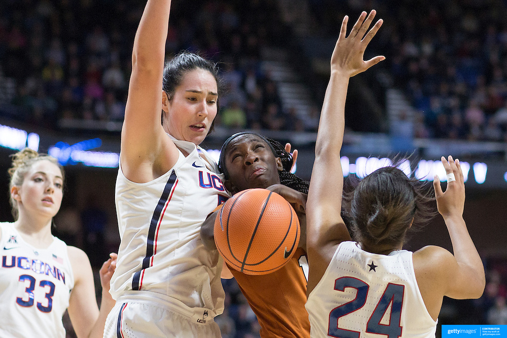 UNCASVILLE, CONNECTICUT- DECEMBER 4: Lashann Higgs #10 of the Texas Longhorns commits a charging foul as she attempts to find a way to the basket past Natalie Butler #51 of the Connecticut Huskies and Napheesa Collier #24 of the Connecticut Huskies during the UConn Huskies Vs Texas Longhorns, NCAA Women's Basketball game in the Jimmy V Classic on December 4th, 2016 at the Mohegan Sun Arena, Uncasville, Connecticut. (Photo by Tim Clayton/Corbis via Getty Images)