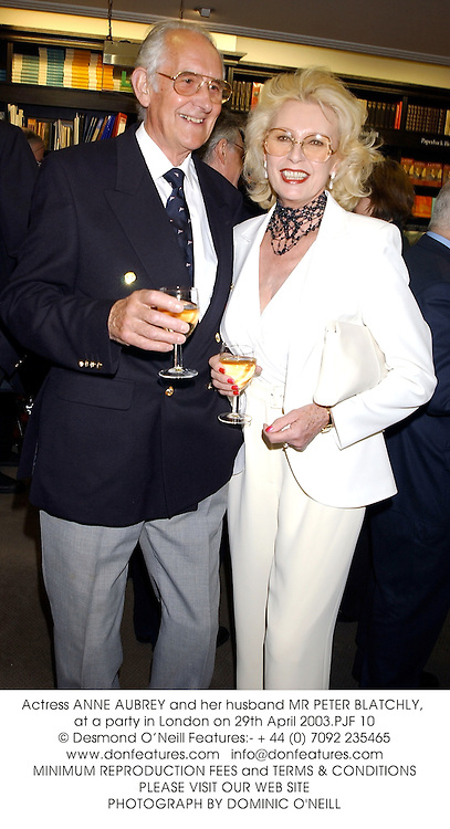 Actress ANNE AUBREY and her husband MR PETER BLATCHLY, at a party in London on 29th April 2003.PJF 10