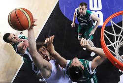 Marc Gasol of Spain between Sani Becirovic of Slovenia and  Gasper Vidmar of Slovenia during the fifth-place basketball match between National teams of Slovenia and Spain at 2010 FIBA World Championships on September 10, 2010 at the Sinan Erdem Dome in Istanbul, Turkey.   (Photo By Vid Ponikvar / Sportida.com)