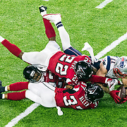 New England Patriots wide receiver Julian Edelman (11) catches the ball against Atlanta Falcons strong safety Keanu Neal (22), Atlanta Falcons cornerback Robert Alford (23) and Atlanta Falcons free safety Ricardo Allen (37) during Super Bowl LI on Sunday, Feb. 5, 2017 in Houston. ThePatriots won in overtime, 34-28. (Ric Tapia via AP)