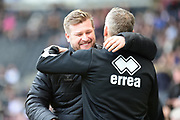 Charlton Athletic manager Karl Robinson embraces Dons Kieith Millen during the EFL Sky Bet League 1 match between Milton Keynes Dons and Charlton Athletic at stadium:mk, Milton Keynes, England on 17 February 2018. Picture by Dennis Goodwin.