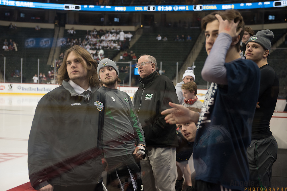 Edina players look at their student cheering section before the Class AA semifinal game between Duluth East and Edina (Duluth East won 3-1) at the Minnesota State High School League Boys' State Hockey Tournament at the Xcel Energy Center in St. Paul, Minnesota on March 6, 2015. <br />  <br /> <br /> Photo by Angela Jimenez for Minnesota Public Radio www.angelajimenezphotography.com
