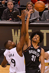 January 11, 2019 - Toronto, Ontario, Canada - Serge Ibaka #9 of the Toronto Raptors against Jarrett Allen #31 of the Brooklyn Nets during the Toronto Raptors vs Brooklyn Nets NBA regular season game at Scotiabank Arena on January 11, 2019, in Toronto, Canada (Toronto Raptors win 122-105) (Credit Image: © Anatoliy Cherkasov/NurPhoto via ZUMA Press)