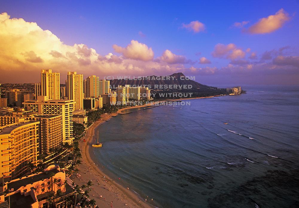 Image of Waikiki Beach and resorts along coastline with rainbow, Honolulu, Oahu, Hawaii.  For editorial captioning, please acknowledge the view from the Sheraton Waikiki Hotel