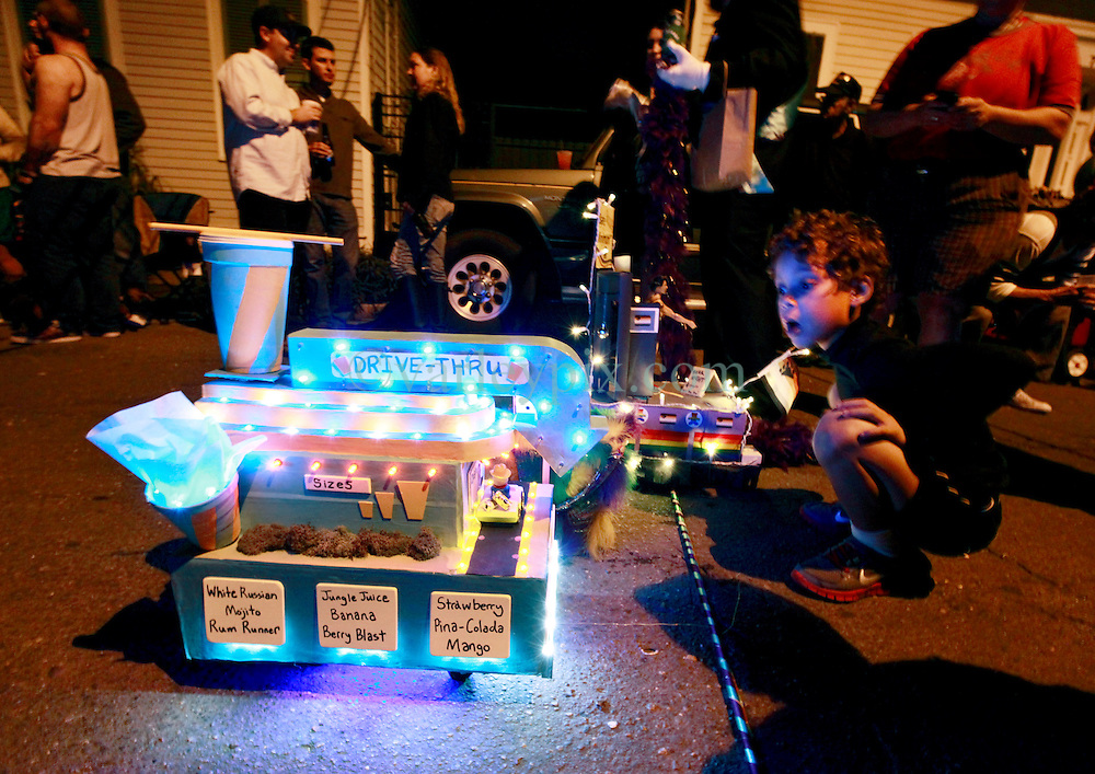 26 January 2013. New Orleans, Louisiana,  USA. .Mardi Gras. 'Tit Rex' miniature float parade, the Micro Krewe rolls with the theme of 'Bare Minimum.' In an age when parades in general get bigger and bigger, Tit Rex takes an opposite approach and shrinks everything down..Photo; Charlie Varley.
