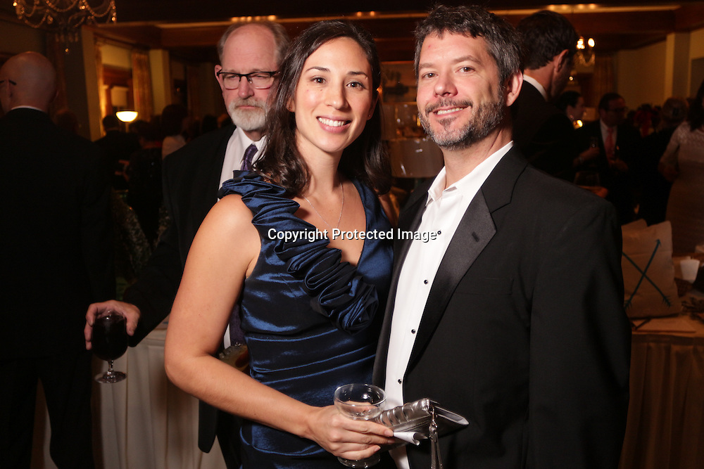 Tiffany Chappell, left, and Robert Chappell pose for a picture Saturday December 6, 2014 during the 9th Annual Wilmington Fur Ball at the Country Club of Landfall in Wilmington, N.C. (Jason A. Frizzelle)