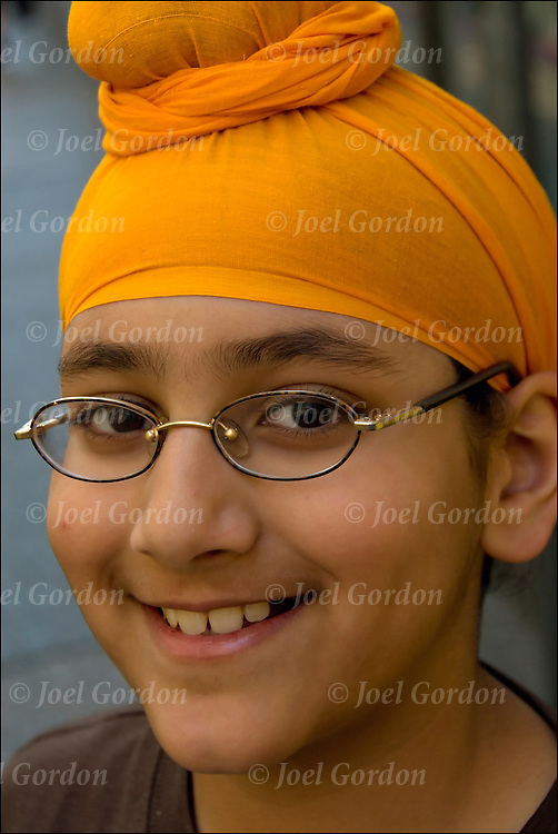 Close up portrait of young Sikh-American boy showing their ethnic pride during the Sikh Day Parade in New York City.