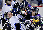 The Thunder's Matt Robinson gets hit in the face with the stick of Oilers' Kyle Bochek as they fight during their game in Tulsa, OK.