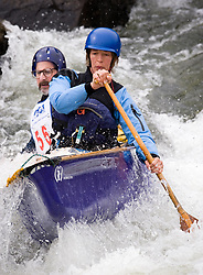 Jojo Newbold (front) and Jonathan Lehmann, both of St. Louis, Missouri race in the OC2 mixed class during the slalom course of the 42nd Annual Missouri Whitewater Championships. Newbold and Lehmann placed fourth place in the class. The Missouri Whitewater Championships, held on the St. Francis River at the Millstream Gardens Conservation Area, is the oldest regional slalom race in the United States.