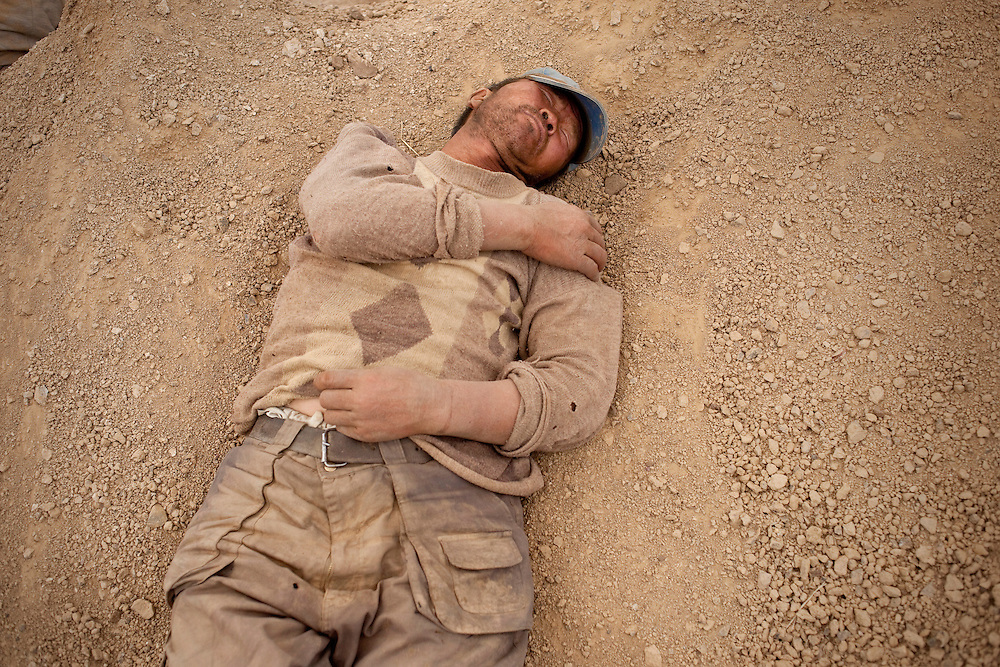 The average monthly income for a Mongolian is $60. Ninja miners can easily make three to four times this amount. Here a miner naps atop his dirt heap near his small pit mine.