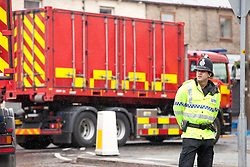 © Licensed to London News Pictures. 26/06/2012. Oldham , UK . A large explosion , believed to be caused by gas , has brought down at least one house in an Oldham terrace. Police and search and recovery fire teams are searching the scene . Photo credit : Joel Goodman/LNP