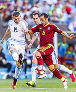 Venezuelan midfielder Alejandro Guerra battles for ball possession over Uruguayan defender Gaston Silva in the first half of a group stage match of the Copa America Centenario at Lincoln Financial Field in Philadelphia, Penn., on Friday June 9, 2016.