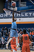 San Diego Toreros guard Braun Hartfield (1) scores on a layup against the Cal State Fullerton Titans during an NCAA basketball game, Wednesday, Dec. 11, 2019, in Fullerton, Calif. San Diego defeated CSUF 66-54. (Jon Endow/Image of Sport)