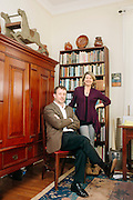 """Stephen Mihm and Bethany Moreton pose for a portrait in Mihm's home in Decatur, Georgia March 31, 2013. Both teach at the University of Georgia and both are authors of books that dissect history through economics. Mihm wrote """"A Nation of Counterfeiters: Capitalists, Con Men, and the Making of the United States"""" and Moreton wrote """"To Serve God and Wal-Mart: The Making of Christian Free Enterprise."""""""