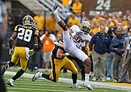 September 17, 2011: Pittsburgh Panthers wide receiver Devin Street (15) pulls in a pass in front of Iowa Hawkeyes defensive back Tanner Miller (5) as Iowa Hawkeyes defensive back Shaun Prater (28) looks on during the second half of the game between the Iowa Hawkeyes and the Pittsburgh Panthers at Kinnick Stadium in Iowa City, Iowa on Saturday, September 17, 2011. Iowa defeated Pittsburgh 31-27.