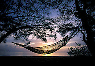 Sunset and Hammock under trees, Fernandez Bay Village, Cat Island, Bahamas