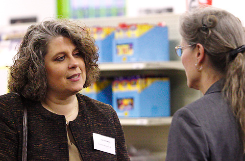 Teresa Zumwald of Zumwald & Company (left) and Beverly Armstrong of MPS Weight Loss & Wellness during a BBB networking event at Crayons to Classrooms in Dayton, Tuesday, February 28, 2012.