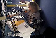 Bruna Miorelli, journalist, on air at the studio of Radio Popolare (Popular Radio) in the new headquarter of the radio at Stradella street, in Milan, 1992. Radio Popolare is an Italian free and indipendent radio station; its programs are broadcasted on FM and streaming and by satellite. &copy; Carlo Cerchioli<br /> <br /> Bruna Miorelli, giornalista, in onda nello studio di Radio Popolare, nella nuova sede della radio in via Stradella a Milano, 1992. Radio Popolare, &egrave; una radio di informazione libera e indipendente; i suoi programmi sono trasmessi in FM e streaming e via satellite.