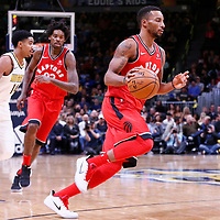 01 November 2017: Toronto Raptors forward Norman Powell (24) drives past Denver Nuggets guard Gary Harris (14) on a screen set by Toronto Raptors center Lucas Nogueira (92) during the Denver Nuggets 129-111 victory over the Toronto Raptors, at the Pepsi Center, Denver, Colorado, USA.