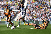 West Bromwich Albion defender Kieran Gibbs (3) leaps a tackle from Hull City midfielder Daniel Batty (18) during the EFL Sky Bet Championship match between West Bromwich Albion and Hull City at The Hawthorns, West Bromwich, England on 19 April 2019.