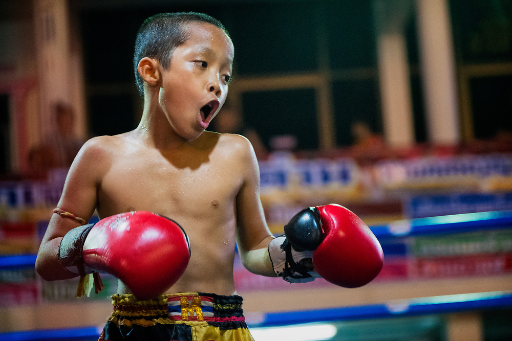 A young Muay Thai fighter at a festival in Nakhon Nayok Thailand.