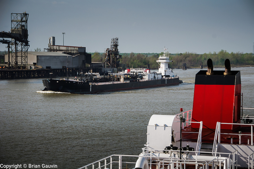 Meeting Crowley ATB tug Acheivment and barge 650-8 near New Orleans. ATB, Legacy and barge 750-1, Crowley Maritime. Transporting primium and regular grade gasoline from Marathon Oil in Garryville, La. to Port Everglades and Tampa Florida.