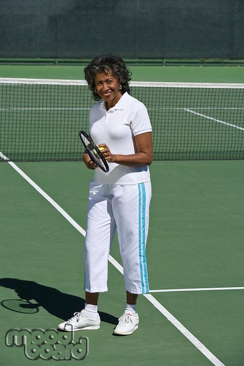 Female tennis player on court, portrait