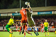 Ollie Palmer (Crawley Town)  & Ralf Fahrmann (GK) (Norwich) during the EFL Cup match between Crawley Town and Norwich City at The People's Pension Stadium, Crawley, England on 27 August 2019.