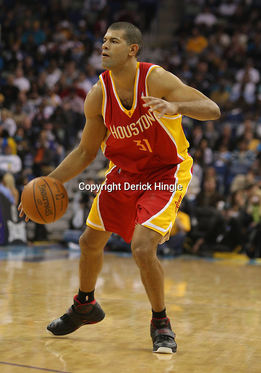 Jan 02, 2010; New Orleans, LA, USA; Houston Rockets guard Shane Battier (31) controls the ball against the New Orleans Hornets during a game at the New Orleans Arena. The Hornets defeated the Rockets 99-95.  Mandatory Credit: Derick E. Hingle-US PRESSWIRE