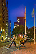 New York City: The bull statue at night, dusk in the Financial District