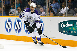 April 4, 2011; San Jose, CA, USA;  Los Angeles Kings defenseman Willie Mitchell (33) skates with the puck against the San Jose Sharks during the first period at HP Pavilion. San Jose defeated Los Angeles 6-1. Mandatory Credit: Jason O. Watson / US PRESSWIRE