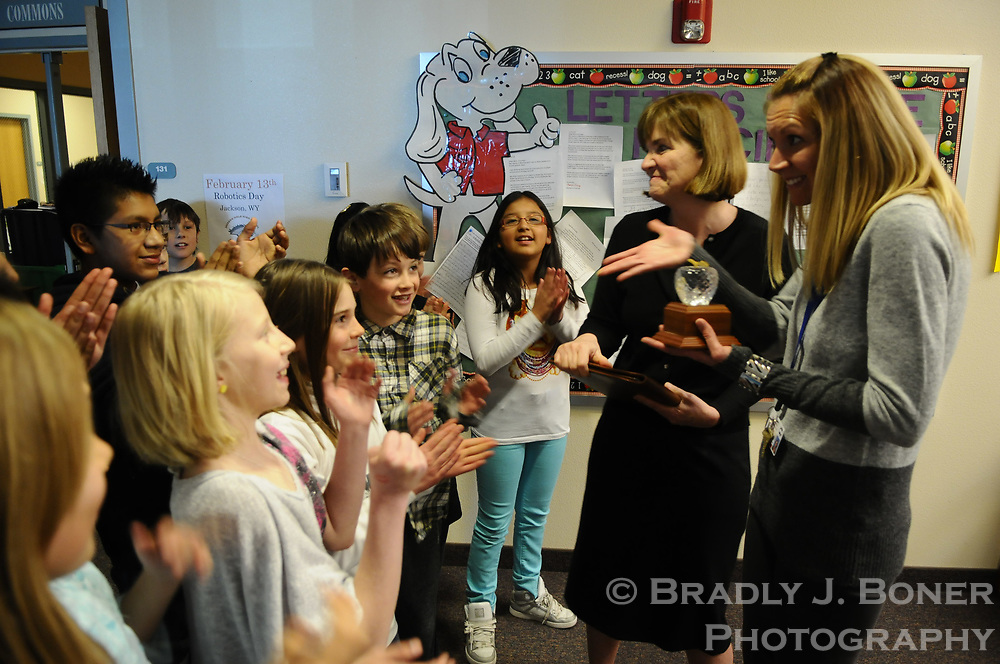 Cindy Hill, Wyoming Superintendent of Public Instruction, gives Teacher of the Year award to Colter Elementary School fifth-grade teacher Carrie Varga
