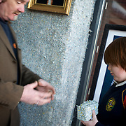 Ireland: Irish artist Frank Buckley explains to a young visitor, how he made the bricks of shredded money used in the cosntruction of his Billion Euro House art installation in central Dublin. ..Worthless euros, taken out of circulation and shredded by Irelands Central Bank, formes the interior walls of an apartment that Mr. Buckley does not own in a building left vacant by the countrys economic ruin...The artist decided to call the apartment  built from thousands of bricks of shredded, decommissioned cash (each brick contains, roughly, what used to be 50,000 euros)  the Billion Euro House. He reckons that about 1.4 billion euros actually went into it, but the joke, of course, is that it is worth simultaneously so much and so little...A large gravestone beside the main door, announces that Irish sovereignty died in 2010, the year that the government accepted an international bailout so larded with onerous conditions that the Irish will be paying for it for years to come. (Paulo Nunes dos Santos/Polaris)