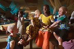 Children play after school in their dormitory at the Kabanga Protectorate Center and School in Tanzania. Residents with albinism make up roughly one-third of the center's population—and 60 percent of them are children. Though violence against children and adults with albinism has been a problem, these kids face an even greater threat: Skin cancer kills 98 percent of Tanzanians with albinism before they reach the age of 40.