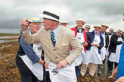 08/09/2013 Singing to the Oysters<br /> <br /> To help wake the Native Oysters from their beds &quot;The Brook Singers&quot;, a male voice choir from Dublin, accompanied by Peter Caviston of Caviston's Food Emporium, (seen here enjoy one of the first of the season straight from the bay )in Glasthule called to Kelly Oysters in inner Galway Bay.<br /> September is a busy month for the Native Oysters which have just come back into season.<br /> The singers will help the oysters prepare for the upcoming Galway international Oyster Festival at the end of the Month . As well as supplying the Oyster Festivals, Kelly Oysters supply oysters throughout Ireland and around the world.<br /> Last season these much sought after delicacies were exported to 14 different countries.   Photo: Andrew Downes