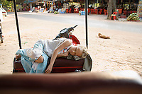 Little Girl Sleeping on Seat of Rickshaw