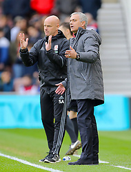 Middlesbrough manager Aitor Karanka (left) and Manchester United manager Jose Mourinho gesture on the touchline