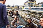 ravers talking on rooftop, Chariot Spa, Fairchild St., Shoreditch, London May 2016.