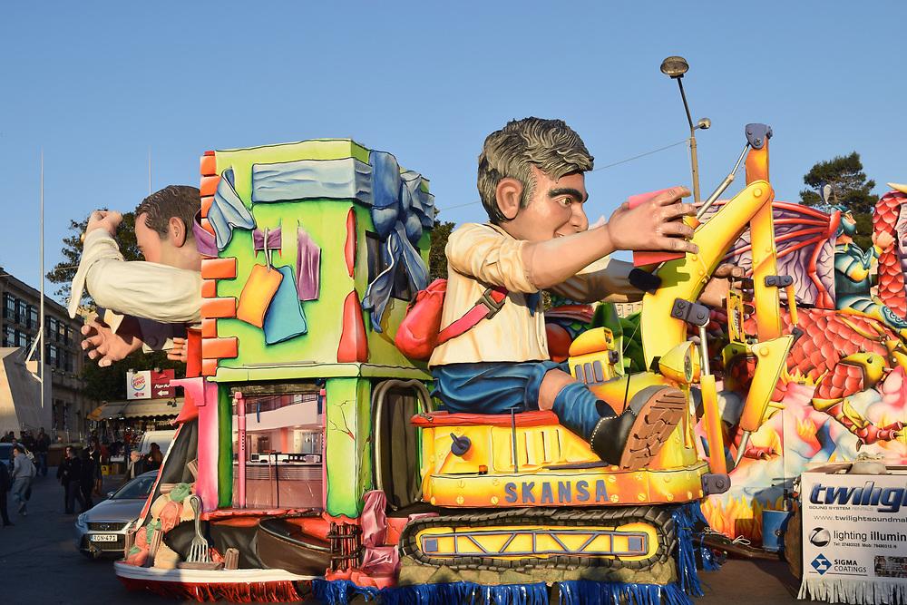 Man on JCB carnival float