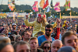 ©London News Pictures. Glastonbury Festival 2015 - Friday, Worthy Farm, Pilton.<br /> <br /> Crowds at sunset.<br /> <br /> Date: 26/06/2015<br /> Photographer: Artur Lesniak /LNP