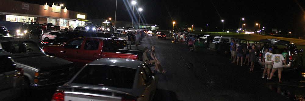 People of different age groups hang out in Glendale Shopping Center parking lot during last year's Cruisin' Amory.