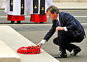 The UK Prime Minister David Cameron lays a wreath at the Cenotaph, London on 15 August 2010 to mark VJ day, the anniversary of Japan's surrender to allied forces and the end of the Second World War in 1945. The Allies had delivered Japan an ultimatum to surrender on 28 July 1945. However, this was ignored and the US then dropped atomic bombs on Hiroshima on 6 August and on Nagasaki on 9 August. While 15 August is celebrated as the day of the surrender, the Japanese administration under General Koiso Kuniaki officially did not deliver the signed surrender document until 2 September, which is also known as VJ Day. © under license to London News Pictures.
