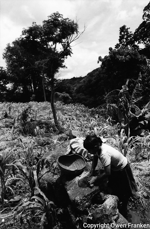 Nicaragua, mother and child washing in the countryside
