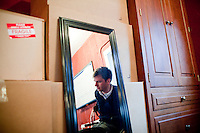29 December, 2009. Bronxville, NY. Francesco Clark, 30, founder and president of Clark's Botanicals, is here in the garage of his home office where he exercises 5 hours every day. Francesco Clark suffers a crippling cord injury due to a swimming pool diving accident on June 1, 2002. Clark's Botanicals was born out of the tragedy.<br /> With his central nervous system impaired, Francesco, who was then an assistant stylist at Harper's Bazar, lost the ability not only to walk, but even to sweat. This led to clogged pores and chronic breakouts. When neither over-the-counter nor prescriptive remedies worked, he turned to his father, Dr. Harold Clark, a physician trained in both traditional Western medicine and homeopathy.<br /> <br /> Together they developed botanically-based formulas that effectively rebalanced Francesco's skin, clearing it up entirely. Through word-of-mouth, other people discovered and fell in love with these products, and in 2005, Francesco began selling Clark's Botanicals on his website.<br /> ©2009 Gianni Cipriano for The New York Times<br /> cell. +1 646 465 2168 (USA)<br /> cell. +1 328 567 7923 (Italy)<br /> gianni@giannicipriano.com<br /> www.giannicipriano.com